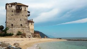 Old tower at the beach in Ouranoupoli, Athos peninsula, Chalkidiki, Greece stock footage