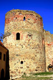 Old tower castle in town Bauska Royalty Free Stock Images
