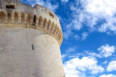 Old tower of castle under blue sky with cloud Royalty Free Stock Photo