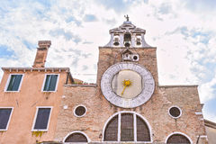 Old tower clock the church of San Giacomo di Rialto on St. James square in Venice. Italy Scenic old streets architecture Stock Images