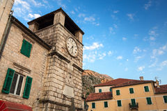 Old tower with clock in Kotor, Montenegro Stock Photos