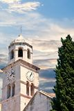 Ancient Clock Tower by Tree Stock Image