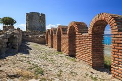 Old tower and excavations of the church on the beach in Nessebar Stock Photos