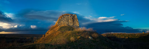 Old tower in front of an approaching storm. Panorama Royalty Free Stock Image