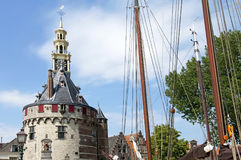 Old tower the Hoofdtoren and masts of sailing ships. Netherlands, North Holland province, region West-Friesland; city, small town Hoorn [municipality Stock Photos