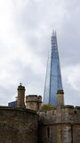 Old Tower and the new Shard in London. Something old (the tower) and something new (the shard at London bridge) in Great Britain Stock Photo