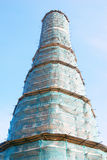 Old tower in Novodevichy convent in Moscow under renovation Stock Photo