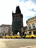 Old tower in the Prague and taxi car royalty free stock photography