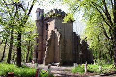 Old tower ruin. Old defensive tower ruin in a park in Romania surounded by trees Royalty Free Stock Photography
