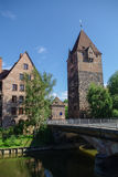 Old Tower Schuldturm and Heubrucke  bridge across  Pegnitz river Royalty Free Stock Photo