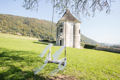 Old tower with swing on the tree stock image