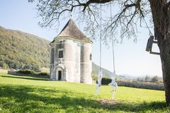 Old tower with swing on the tree royalty free stock images