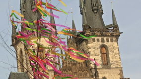 Old towers behind the waving Easter fringes. This video shows waving colorful Easter fringes in front of the old Prague church towers and blue sky. This has been stock video