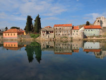 Old town. The old town reflection in the most clear river in Europe - Trebisnjica stock photo
