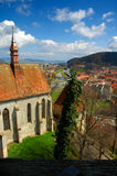 Old town. Aerial view of the old town of Sighisoara. A gothic church is visible on the left side Stock Image
