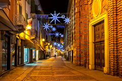 Old town of Alba decorated for Christmas at evening. Royalty Free Stock Image