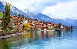 Old town and Alps mountains on Brienzer Lake, Switzerland Stock Images