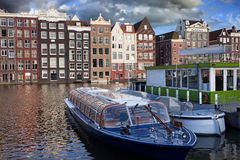 Old Town of Amsterdam in Netherlands. Picturesque Old Town of Amsterdam with terraced historic houses and boats on a canal. City centre, sunset time, North Stock Image