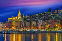 Old town architecture of Menton on French Riviera. By night royalty free stock image