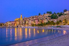 Old town architecture of Menton on French Riviera. By night stock photos