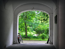 Old town archway with bicycle Stock Photography