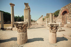 Old town area with broken columns and ruined defensive walls of Greek-Roman city Ephesus. Stock Photo