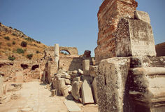 Old town area with columns and ruined defensive walls in Roman empire Ephesus city Royalty Free Stock Photography