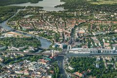 Old town Berlin Spandau with town hall, train station and `Spandau Arcaden` in front, with the river Havel royalty free stock images