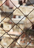 Old town, blurred, through a wire mesh Royalty Free Stock Photos