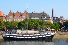 Old town of Bremen and old sailing ship on Weser river, Germany Stock Photo
