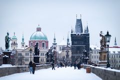 Free Old Town Bridge Tower By The Famous Charles Bridge. The City Of Prague Covered With Snow Royalty Free Stock Photo - 135908745