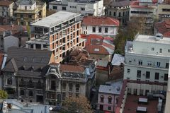 Old town Bucharest. BUCHAREST, ROMANIA - October 29, 2018: Construction site near an old building in Bucharest, seen from above royalty free stock photo