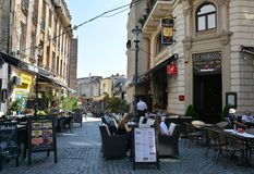 Old town of Bucharest, Lipscani District. BUCHAREST, ROMANIA - SEPTEMBER 13, 2017. Old town of Bucharest, Lipscani District with amazing atmosphere, terrace Stock Images