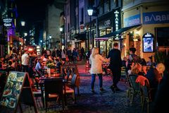 Old town in Bucharest by night with tourists. BUCHAREST, ROMANIA - OCTOBER 2017 Old town in Bucharest by night , Romania Royalty Free Stock Photography