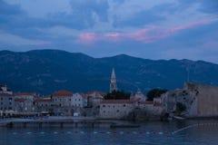 The old town of Budva, St John's Church, mogren beach, sunset. Budva, Montenegro Church of St. John, mogren beach royalty free stock photo