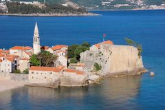 A view of the Old Town of Budva and Richard`s Head beach, Budva, Montenegro. The Old Town of Budva is a tourist destination in Montenegro and one of the most Royalty Free Stock Photos