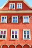 Colorful old town building facade. Old town building with bright orange decorative facade in poznan poland royalty free stock photo