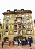 Old town buildings Lucerne Switzerland. Tourists sightseeing on square in the old town Altstadt of Lucerne Switzerland Stock Photo
