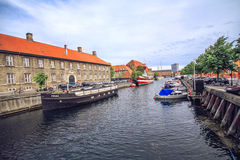 Old Town and canal in Copenhagen, Denmark in a summer day. COPENHAGEN, DENMARK - JUNE 15: Scenic summer view of the Old Town and canal in Copenhagen, Denmark in stock image