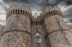 Old town castle at night with two tower of Greek Rhodes old castle royalty free stock image