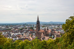 The old town and cathedral of Freiburg, Germany. From a hill Stock Photos