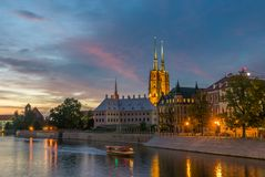 Old town cathedral over vivid colorful sky in Wroclaw Stock Images