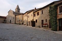 Old town with church. View of the main square of an old village with a church and houses made of stones Royalty Free Stock Image