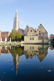 Old town and church in Brugge Stock Images