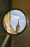 Old town church of Sibiu refecting in a mirror. Of motorcycle Royalty Free Stock Images