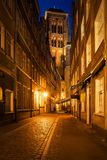 Old Town of Gdansk by Night in Poland. Old Town in city of Gdansk at night in Poland, Kramarska street with St Mary Church at the end Stock Photo