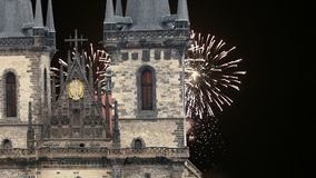 Old Town City Hall and holiday fireworks  in Prague, view from Old Town Square, Czech Republic.  stock footage