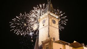 Old Town City Hall and holiday fireworks  in Prague, view from Old Town Square, Czech Republic.  stock video