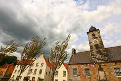 Old town clock and houses in Culross, Scotland Stock Photography