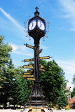 Old town clock. Metal clock in the middle of traffic roundabout royalty free stock photos
